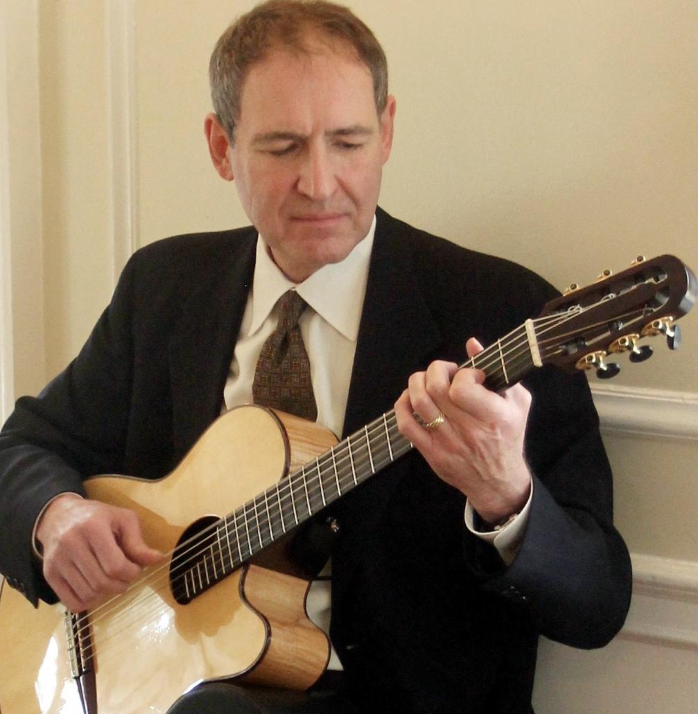 Michael Kolmstetter playing guitar